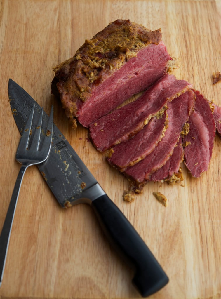Corned Beef slowly simmered in beer; then baked with a mustard horseradish crust.
