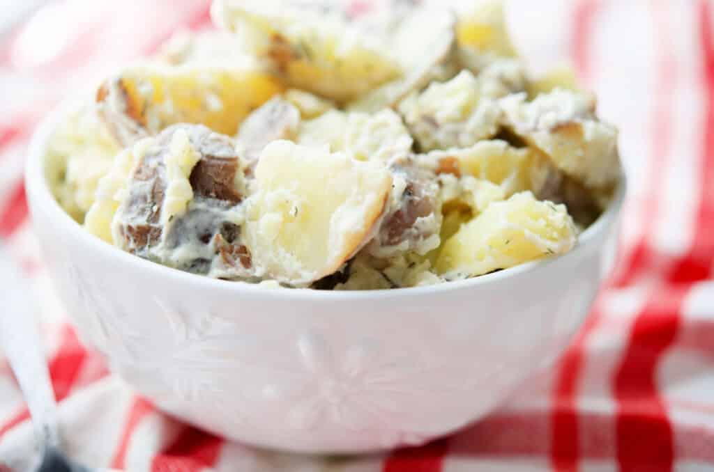 Red Bliss Dill Potato Salad in a white bowl