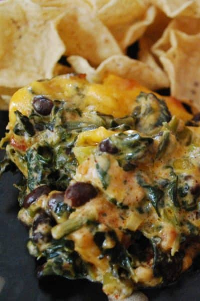 Fiesta Chicken Spinach Dip made with chili rubbed chicken, spinach, black beans, tomatoes and cheddar cheese makes a tasty game day snack.