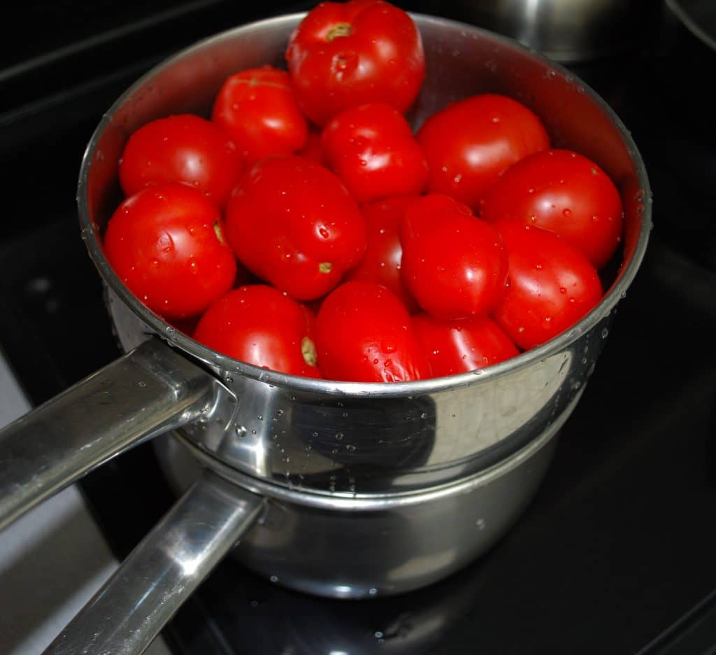 Fresh garden tomatoes in steamer pot
