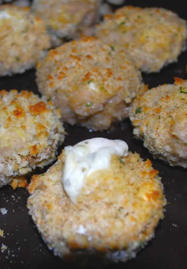 Mushrooms stuffed with garlic & herb spreadable cheese; then breaded and baked until the cheese is oozing from the center.