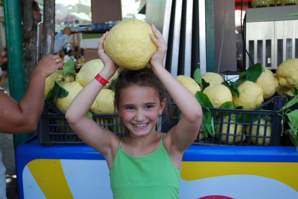 Gabrielle with a large lemon in Sorrento