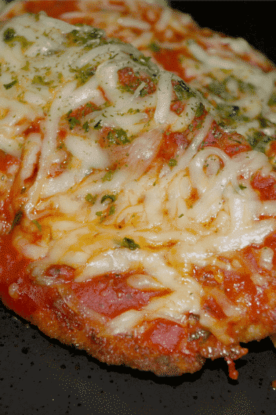 Chicken Parmesan made with breaded and fried boneless chicken breasts topped with your favorite marinara sauce and shredded Mozzarella cheese; then baked until hot and bubbly.