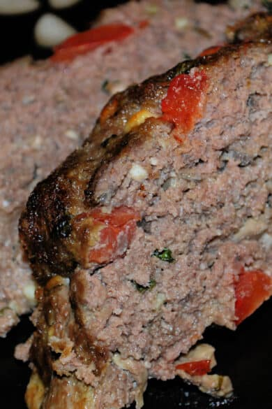 Tomato, Basil and Feta Meatloaf made with lean ground beef, vegetables and crumbled Feta cheese makes a super flavorful weeknight meal.
