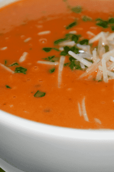 Asiago Tomato Basil Soup made with crushed tomatoes, fresh basil, vegetable broth, heavy cream and shredded Asiago cheese is deliciously satisfying and can be ready in about 15 minutes.