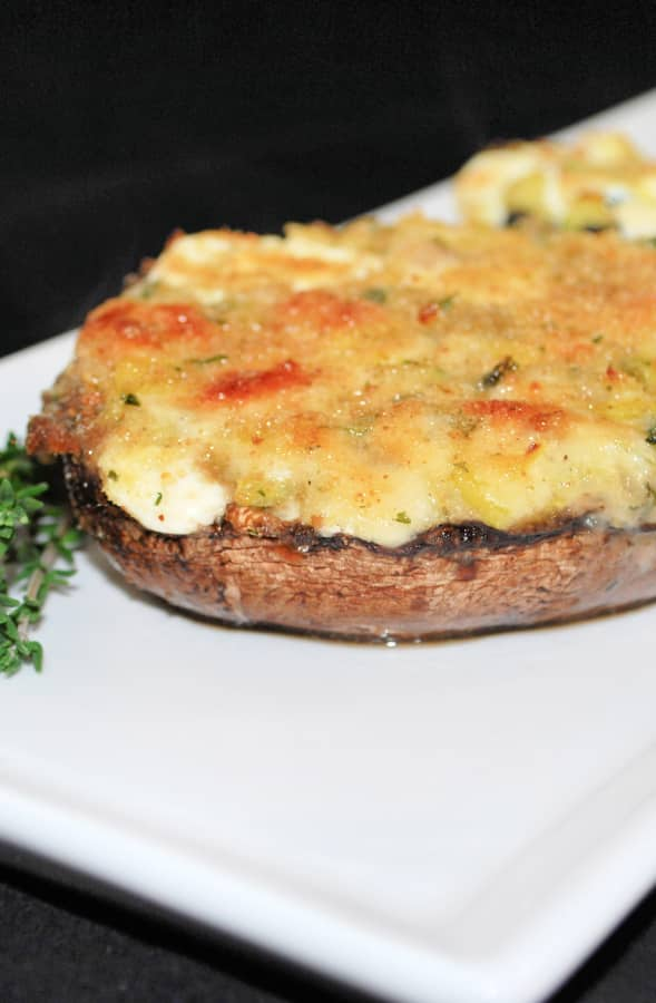 Three Cheese Zucchini Stuffed Portobello Mushrooms on a white serving dish