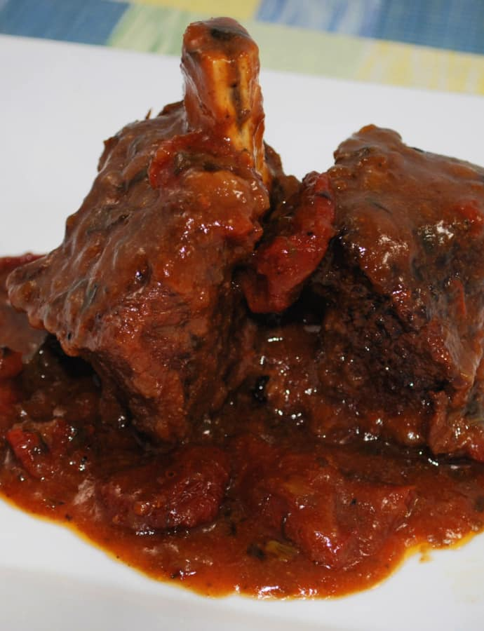 These Beef Short ribs slowly cooked in a fragrant Sun Dried Tomato BBQ Sauce are fall off the bone tender and delicious!