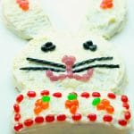 Easter Bunny Cake made with boxed carrot cake and homemade cream cheese icing; then decorated with your favorite candy is a fun treat for the kids to help make this Easter.