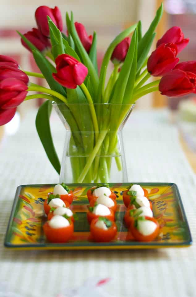 Cherry tomatoes stuffed with fresh mozzarella cheese and basil; then drizzled with extra virgin olive oil and balsamic vinegar.
