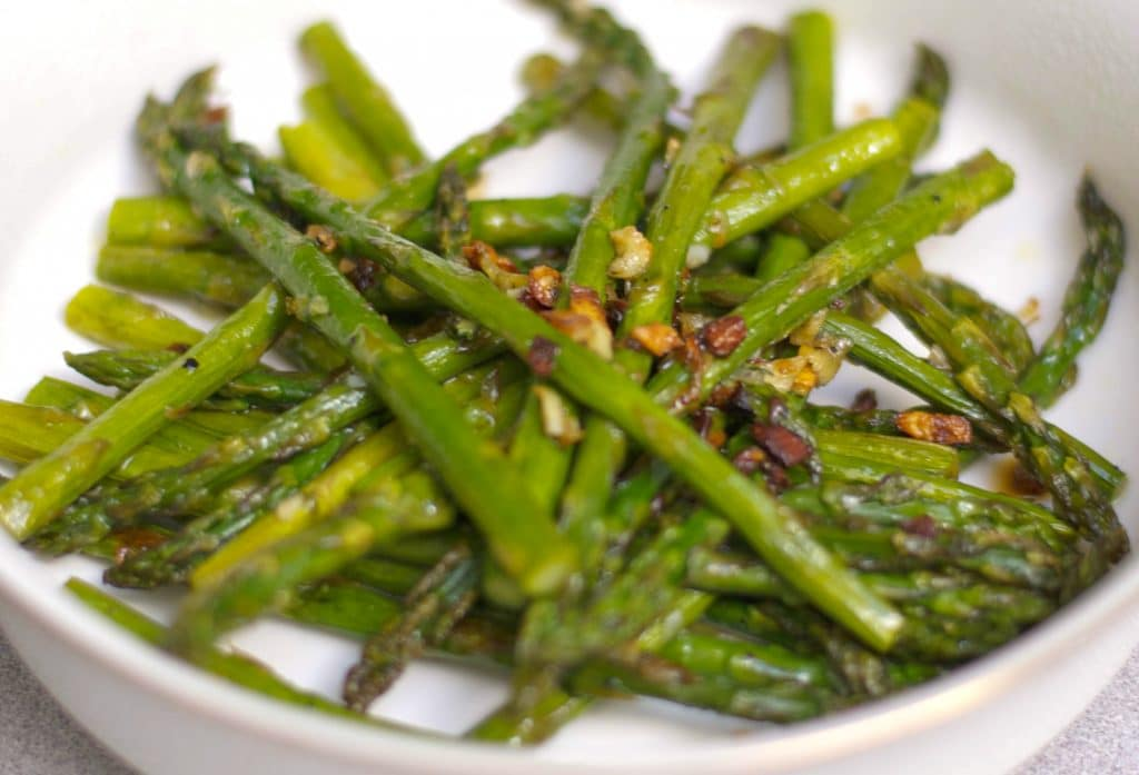 Fresh asparagus tossed with garlic, extra virgin olive oil, Kosher salt and fresh ground pepper; then roasted until caramelized.