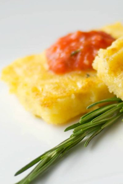 Italian Polenta made with yellow cornmeal, sea salt and fresh rosemary; then grilled and topped with a Roasted Roma Tomato Coulis.