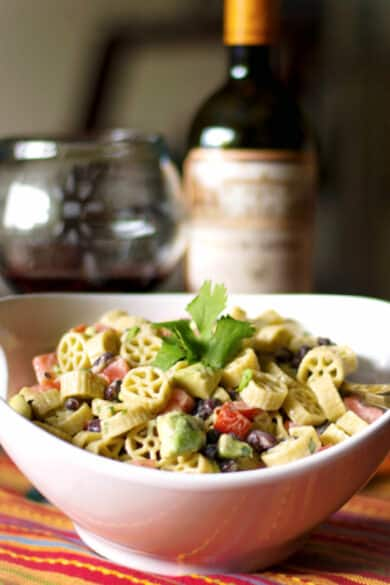 Pasta salad with fresh avocado, black beans and tomatoes in a Goat cheese, lime vinaigrette is delicious and super flavorful.