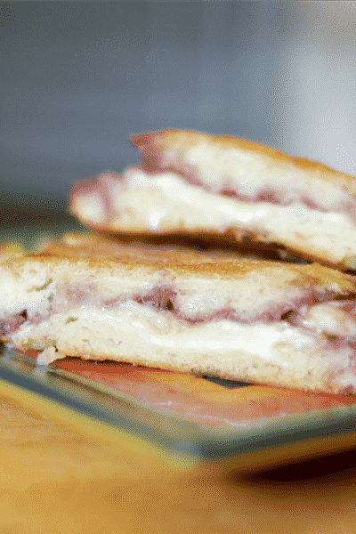 This panini made with creamy Brie cheese and sweet seedless raspberry jam makes a tasty lunch or quick dinner sandwich.