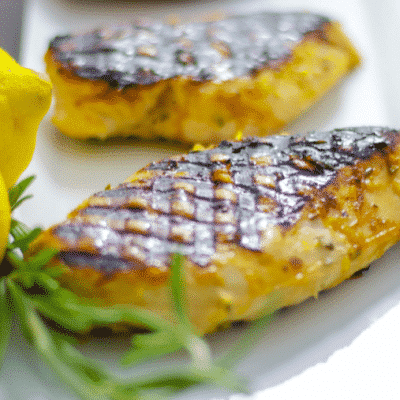 Boneless chicken breasts marinated in a combination of honey, lemon juice and rosemary; then grilled is a healthy, low fat delicious weeknight meal.