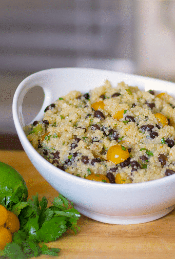Quinoa tossed with black beans and golden sunburst tomatoes in a lime and ginger vinaigrette dressing makes a refreshingly tasty light salad.