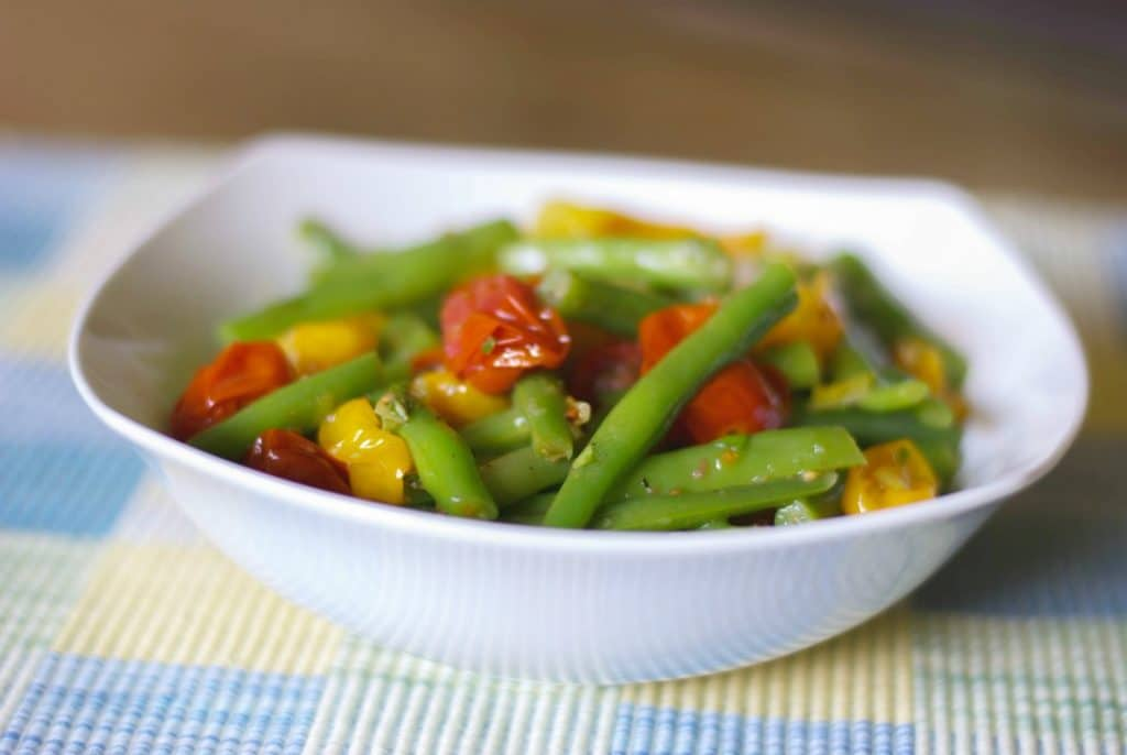 Roasted Grape Tomato and Green Bean Salad tossed with red and green tomatoes, leeks and garlic in a light Lemon Basil Vinaigrette