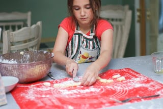Gabby forking the homemade gnocchi
