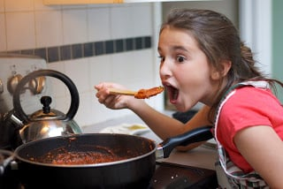 Gabby tasting the sausage bolognese sauce