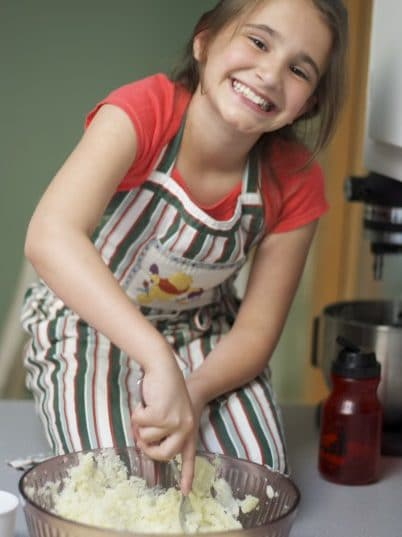 Homemade Gnocchi with Sausage Bolognese is so easy to make, I enlisted my 10 year old to show you how to make it yourself.