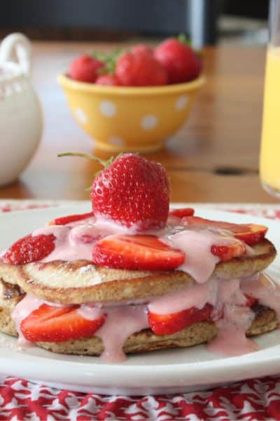Homemade Strawberry Shortcake Pancakes made with flaxseed, whole and white flours, almond milk and strawberries topped with Chobani sauce.