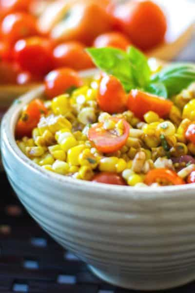 Corn and Tomato Salad made with fresh corn on the cob and garden cherry tomatoes tossed with aged balsamic vinegar and extra virgin olive oil.