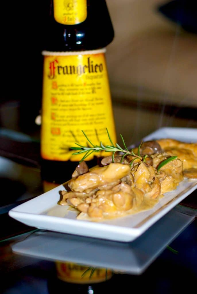 Braised chicken thighs with Cremini mushrooms and fresh rosemary in a Frangelico, red wine cream sauce is a deliciously flavorful, quick weeknight meal.