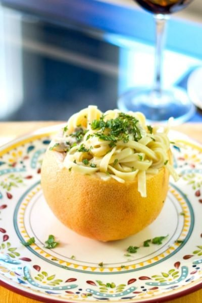 Fettuccine pasta tossed with mushrooms in a light pink grapefruit and fresh mint sauce is deliciously light and flavorful.