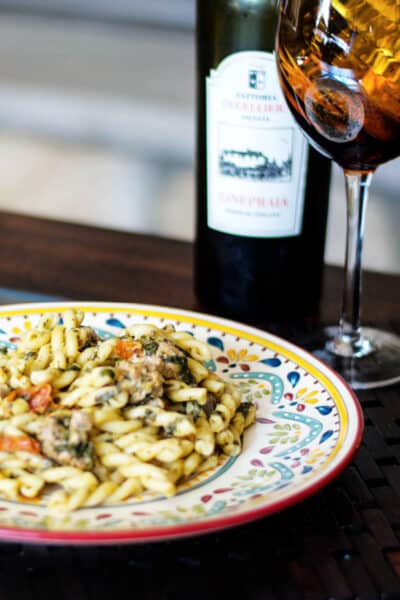 Gemelli pasta tossed with sweet Italian sausage, sun dried tomatoes, creamed spinach, garlic and white wine.