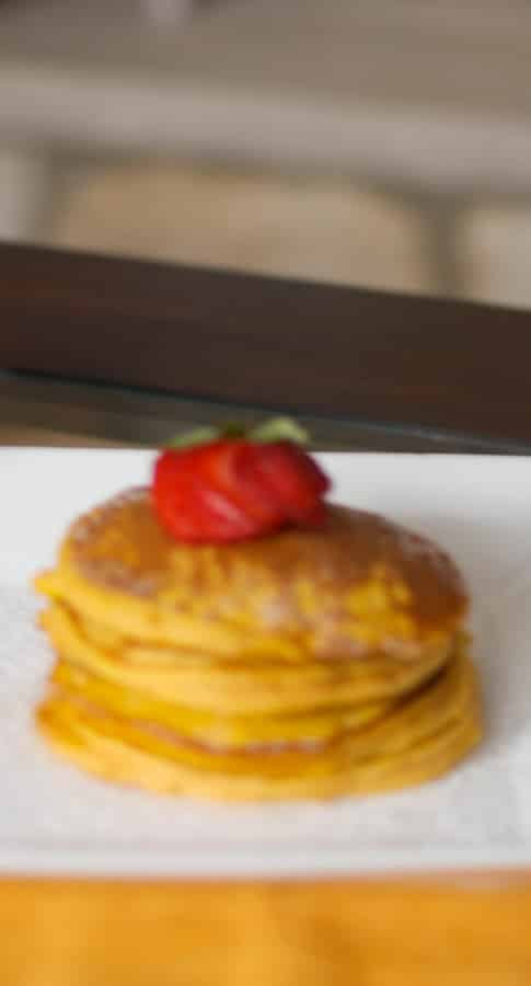 Homemade pancakes made with pumpkin spice and pure pumpkin are a tasty treat for breakfast on a Fall morning or holiday brunch.