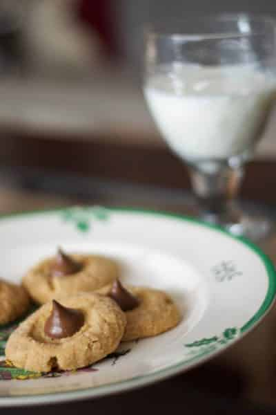 Peanut Butter Blossoms made with Hershey's Kisses are my family's favorite cookie; then again who could resist the combination of chocolate and peanut butter?
