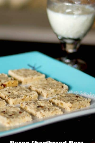 Pecan Shortbread Bars or commonly known as Pecan Sandies, are made with four ingredients. Their rich and buttery flavor make these the perfect treat all year long.