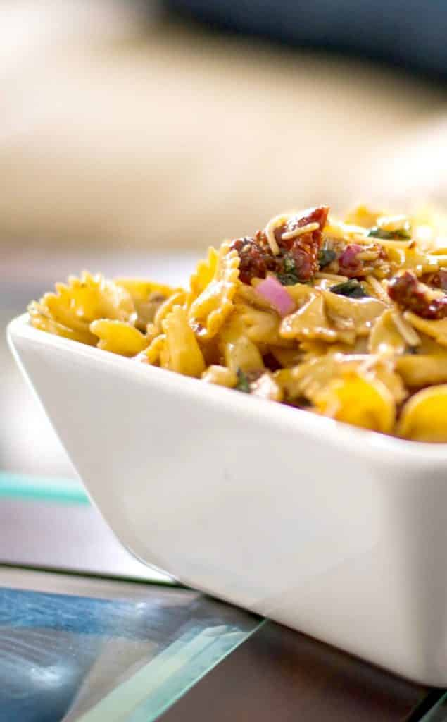 Sun Dried Tomato and Asiago Cheese Pasta Salad in a white square bowl