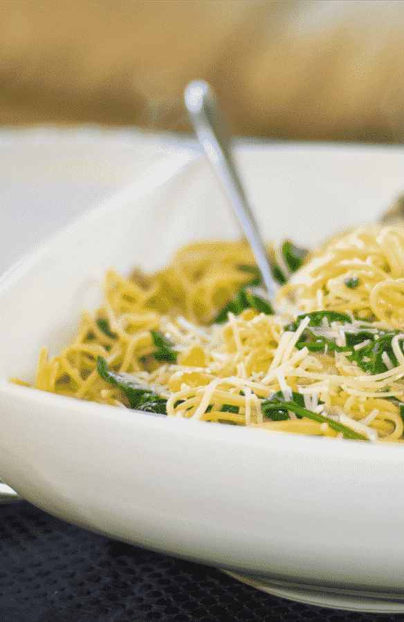 Whole Grain Spaghetti with Sauteéd Chick Peas and Spinach tossed with extra virgin olive oil and garlic; then topped with shredded Asiago cheese.