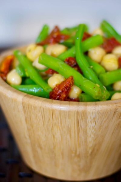 This Mediterranean inspired salad made with garbanzo and green beans, sun dried tomatoes and oregano in a lemony vinaigrette is deliciously light and flavorful.