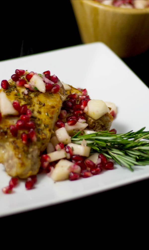 Pan seared boneless, center cut pork chops topped with a fresh pear and pomegranate salsa is a quick and tasty weeknight meal your family will love.