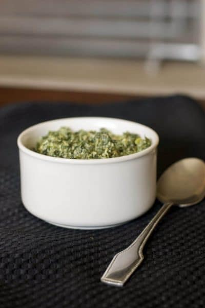 This Herb Creamed Spinach made with spinach, mushrooms, garlic & herb cheese spread and white wine is a tasty side dish that can be ready in minutes.