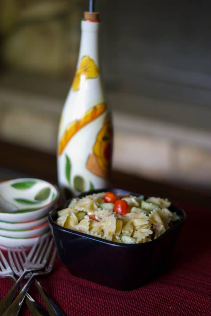 Mediterranean Pasta Salad made with fresh garden cucumbers, tomatoes and crumbled feta cheese. A simple, flavorful salad you can make in 30 minutes that goes well with just about anything else you decide to serve.