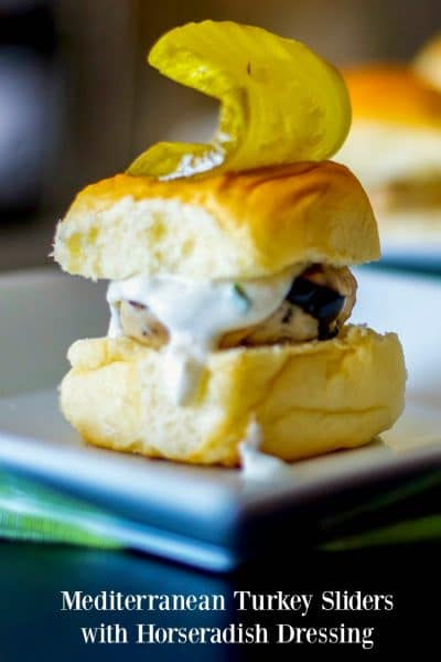 Mediterranean Turkey Sliders made with lean ground turkey, Kalamata olives, Feta cheese, and oregano on top of a sweet slider bun.