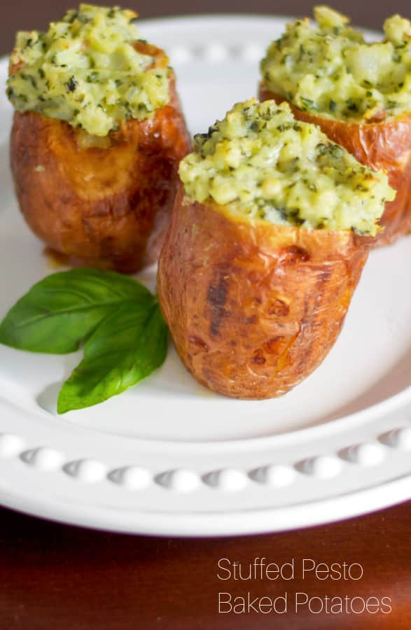 Stuffed baked potatoes made with fresh basil pesto and spices; then baked until super creamy and delicious makes a super flavorful side dish.
