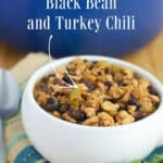 Black Bean and Turkey Chili in a white soup crock and a blue Dutch oven