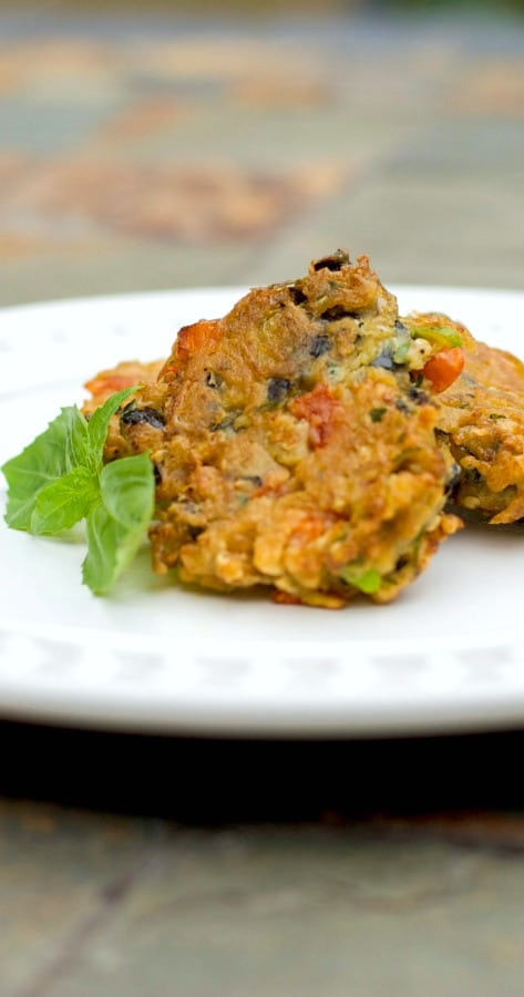 Learn how to make this tasty Greek style side dish for Eggplant Fritters with grated eggplant, garlic, basil, tomatoes and scallions.