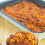 Linda's Portuguese Baked Beans made with Navy beans, Portuguese chorizo, peppers, garlic in a tomato-based sauce.