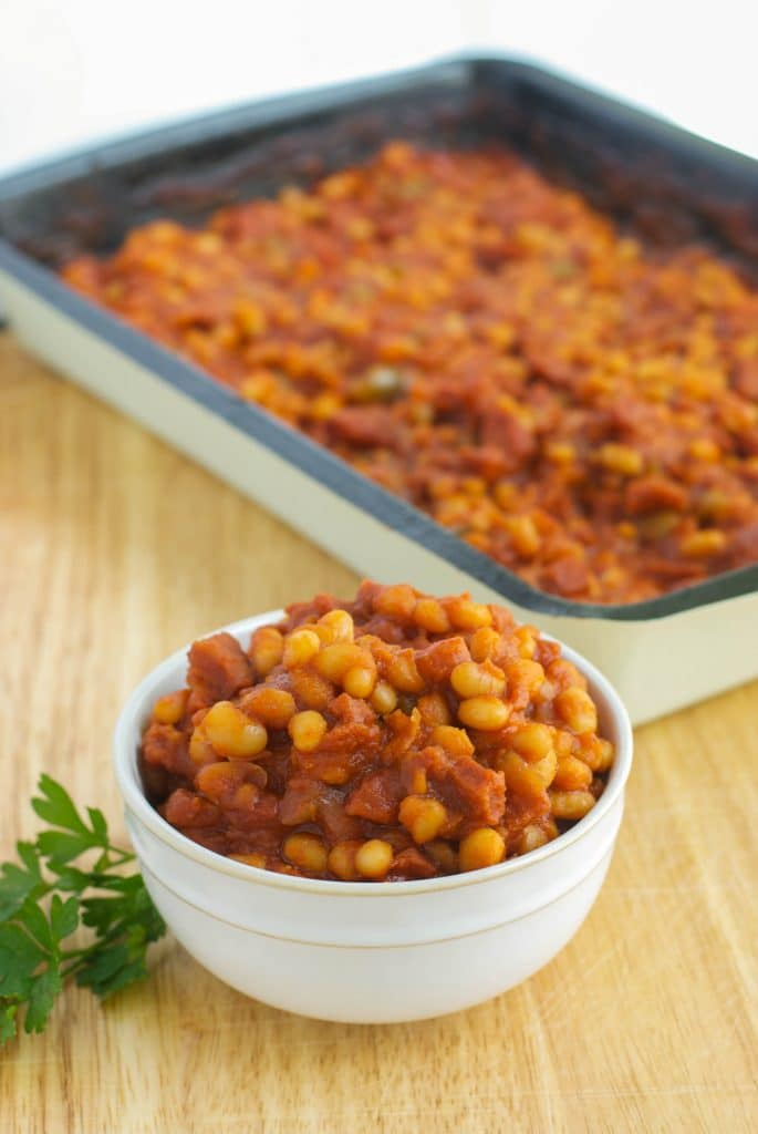 Navy beans cooked with Portuguese chorizo, peppers, garlic and tomatoes in a tomato based sauce. Take them on the go with portable Chinet Bakeware.