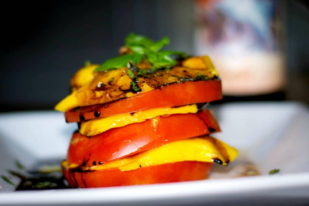 Stacked Heirloom Tomato & Mangoes with Balsamic Reduction