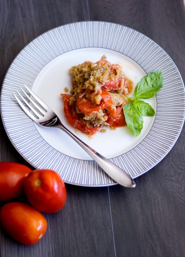 Tomato Gratin made with vine ripened tomatoes layered with garlic, olive oil and Asiago cheese; then topped with buttery Italian breadcrumbs and baked until golden brown.