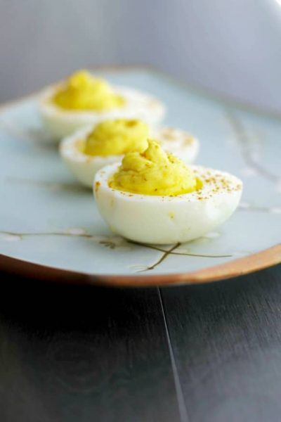 Deviled Eggs made with wasabi paste and horseradish are sure please those that love a little heat in their food.