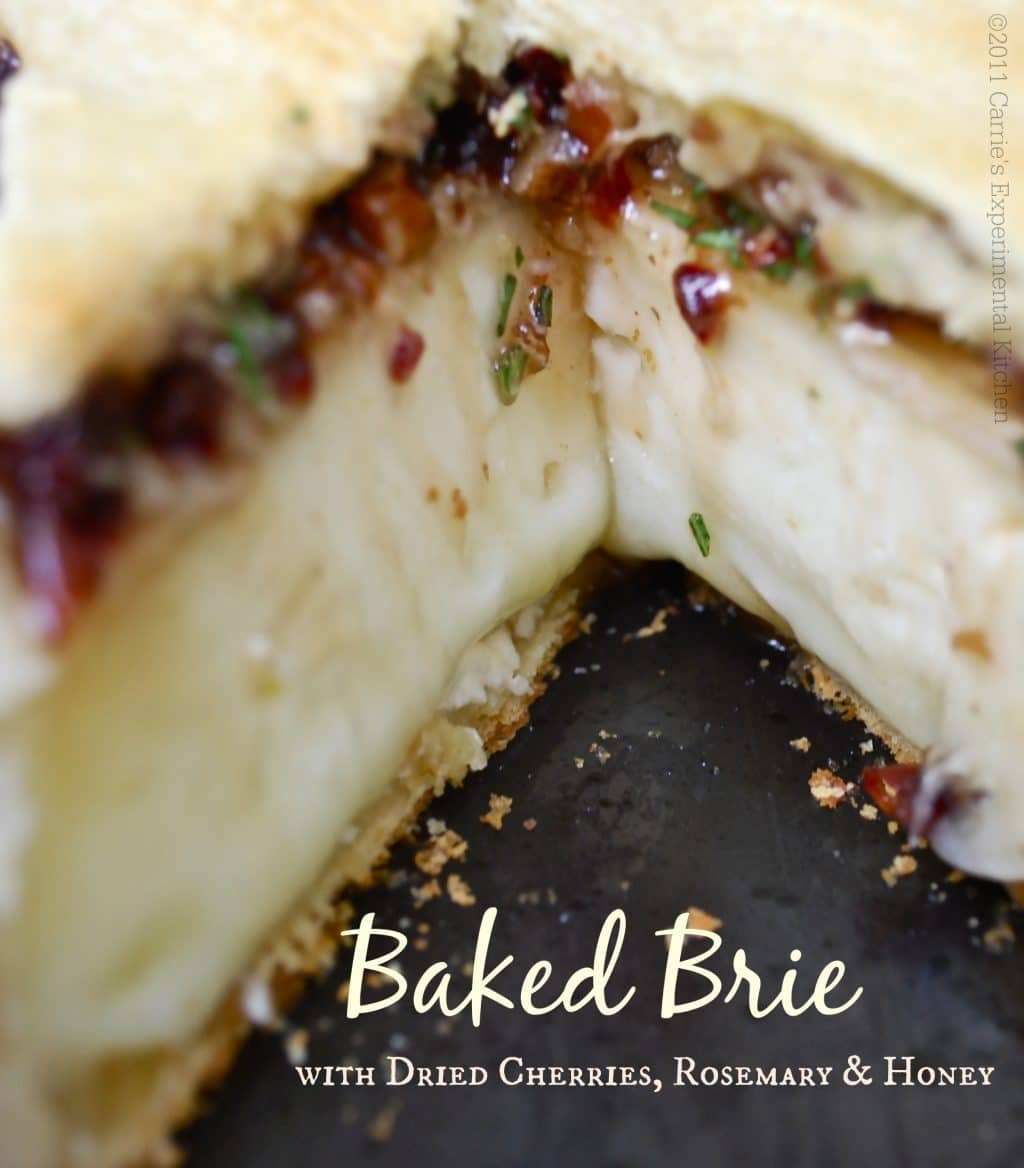 The combination of the cherries,pecans, and fresh rosemary give this baked Brie a sweet, woodsy flavor that has been a favorite appetizer in my family for years. #appetizer #cheese