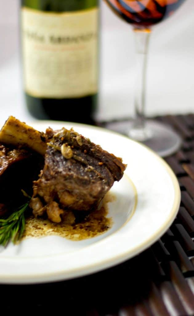 Beef short ribs slowly cooked in red wine, garlic, rosemary and two types of mustard are so tender and delicious.