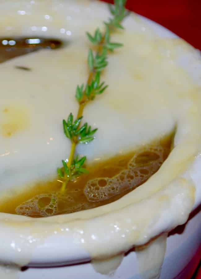 French Onion Soup is a classic soup made with sweet Vidalia onions, beef and chicken broth, cognac and fresh thyme; then topped with melted Swiss cheese.