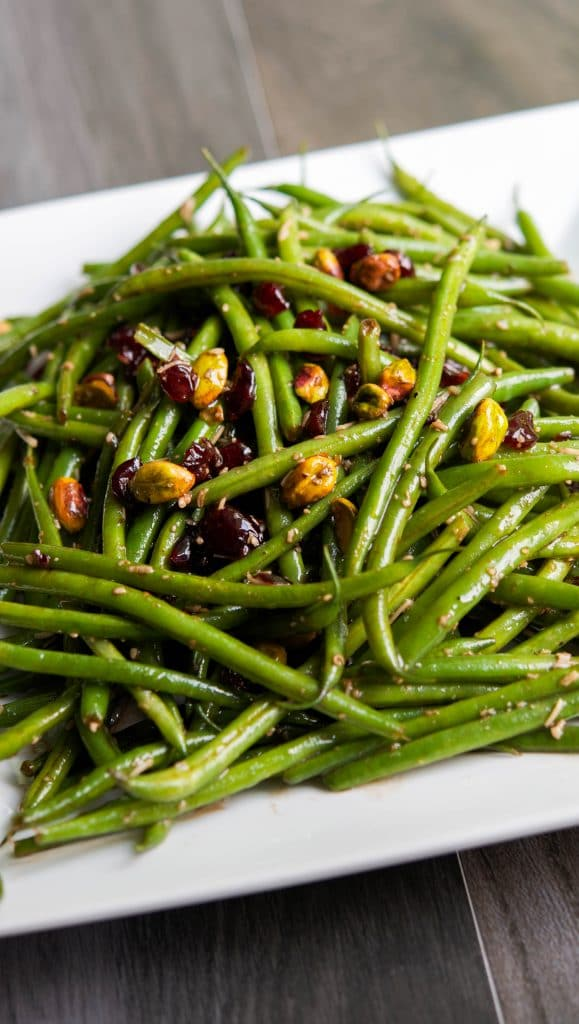 Tender French green beans tossed with Feta cheese, dried cranberries and pistachios in a light balsamic vinaigrette.